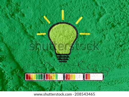 Light bulb with Charging Battery Power Idea on wall texture background design - stock photo
