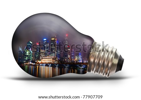 light bulb with city scape at night - stock photo