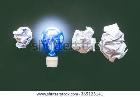 Light bulb with crumpled office paper - stock photo