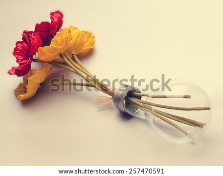 light bulb with  flowers inside - stock photo