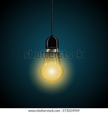 light bulb with glowing  on dark blue background