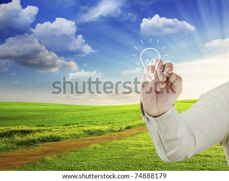 light bulb with hand - stock photo
