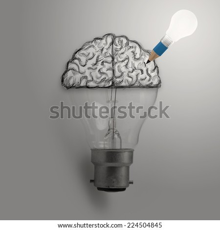 Light bulb with hand drawn brain as creative idea concept - stock photo