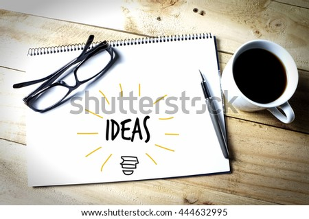 Light bulb with idea word on a sketch book - stock photo