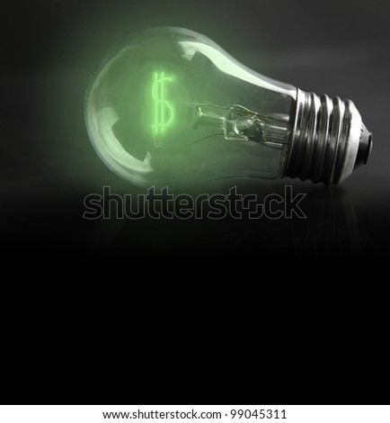 light-bulb with money-sign filament (energy costs) - stock photo
