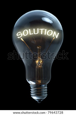 Light bulb with solution text on black background - stock photo