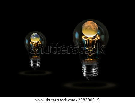 """Light bulb with the same fate as the two planet (Earth and Mars) inside and global warming """"Elements of this image furnished by NASA """"  - stock photo"""