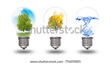Light bulb with three elements inside: nature, fire and water. The concept of renewable energy - stock photo