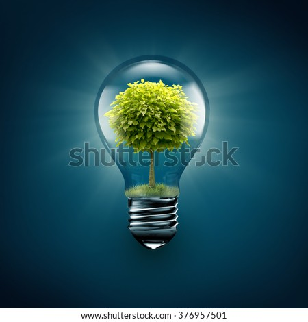 light bulb with tree inside on a blue background - stock photo