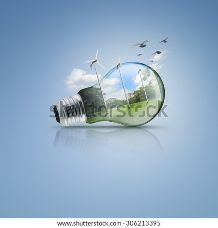 Light bulb with windmill and forest inside, Ecological concept
