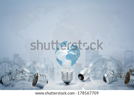 Light  bulb with world map and city