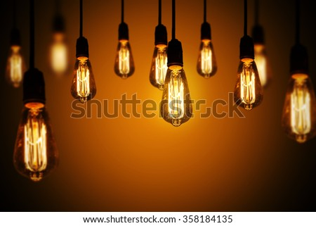 light bulbs on a warm gradient background - stock photo