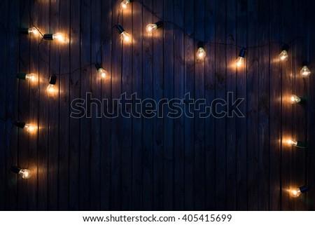Light bulbs on dark Wooden Background - stock photo