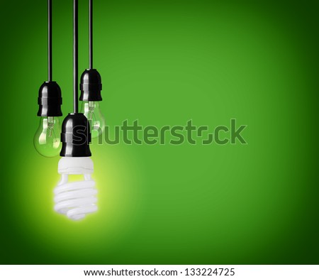 Light bulbs on green background - stock photo