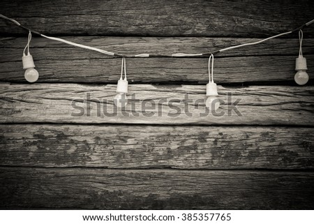Light bulbs on Wooden Background - stock photo