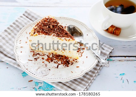 light cheese cake and a cup of tea, food closeup
