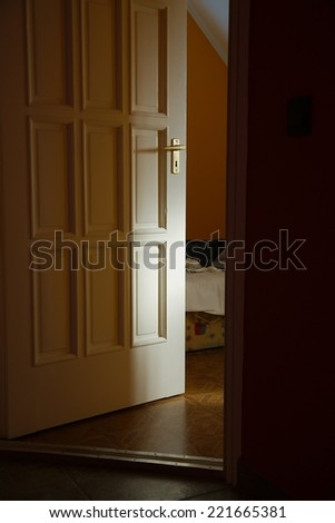 Light coming from a room with door left ajar
