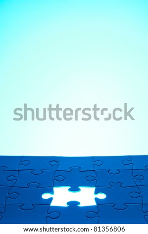 Light coming from the missing jigsaw puzzle: business / human resources concept - stock photo