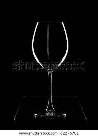 Light contour of wineglass in dark color - stock photo