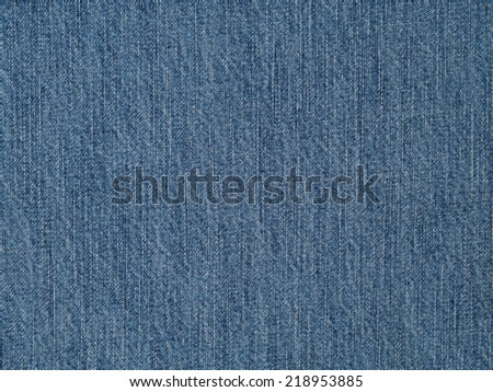 Light denim fabric cloth surface texture, jeans background - stock photo