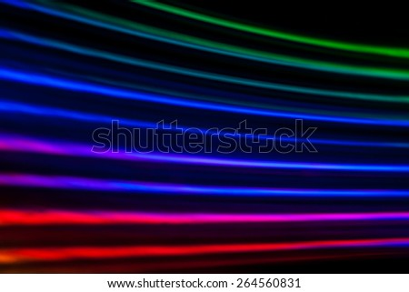 Light dispersion from a compact disk surface. Rainbow effect. - stock photo