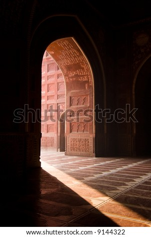 Light entering the Taj Mahal mosque through a doorway - Agra, Uttar Pradesh, India - stock photo