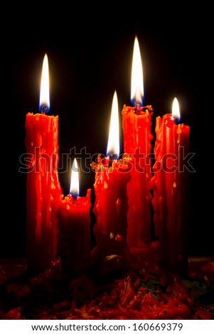 light Five Red candles with black background
