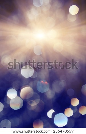 Light flare and flying water drops drfocused background - stock photo