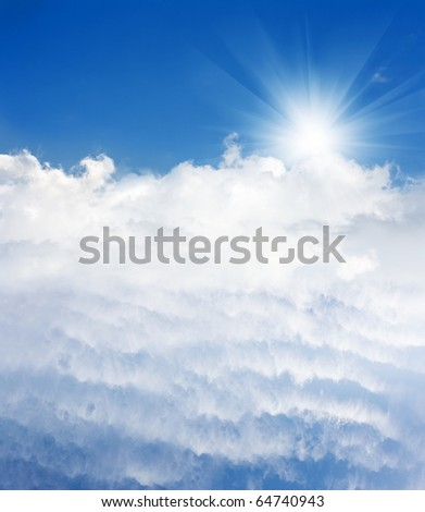 Light from heaven. Clear blue sky, bright sun and beautiful white clouds.