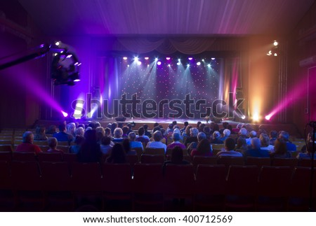 Light from the scene during the concert.  light in the theater, a concert. - stock photo