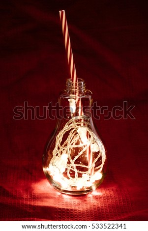 Light Glass Idea Concept for Xmas with Red Velvet background