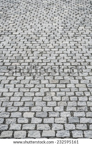 Light gray granite cobble stone pavement, the base of the modern street architecture