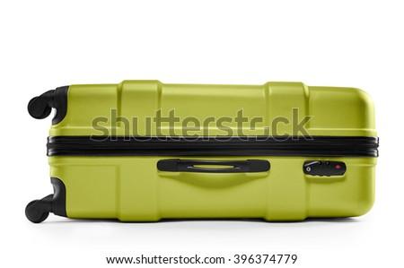 light green suitcase. lying horizontally - stock photo