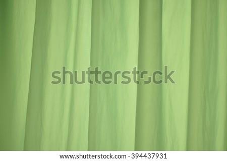light green vertical drapery fabric curtains  folds - stock photo