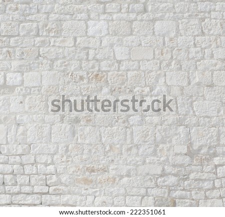 light grey stone wall.  - stock photo