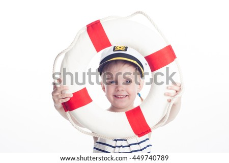 Light hair little girl in captain hat with Lifebuoy on white background