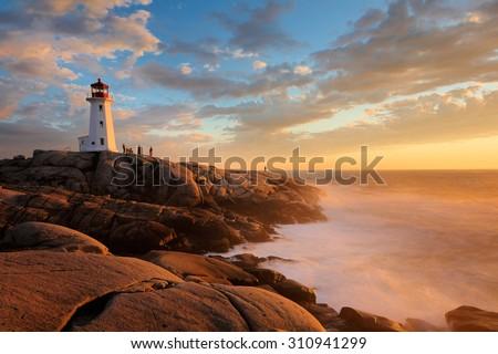 Light House at Peggy Cove at Sunset, Nova Scotia, Canada - stock photo