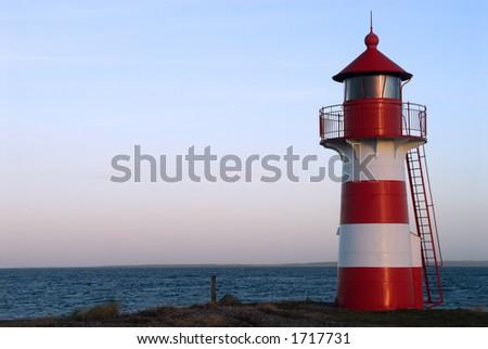 Light house in warm evening light. Jutland, Denmark, Scandinavia - stock photo