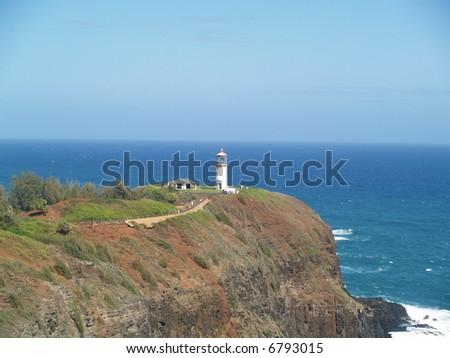 light house on blue sky - stock photo
