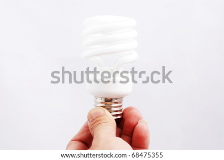 Light  in a hand isolated on white background