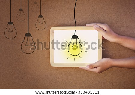 light in frame and hand hold concept idea power - stock photo