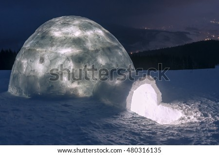 light in real snow igloo. Night scene. Winter landscape