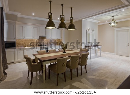 Light Kitchen Combined With A Dining Room Brass Chandeliers In Retro Style