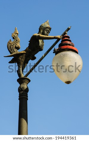 light lamp and angel on blue sky - stock photo