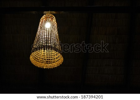 Light lamp made of bamboo woven.    - stock photo