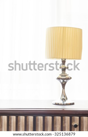 Light lamp on table decoration in bedroom