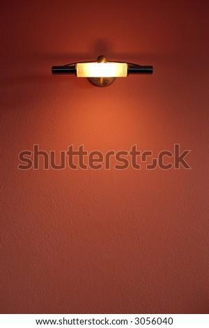 Light lamp over a orange wall - stock photo