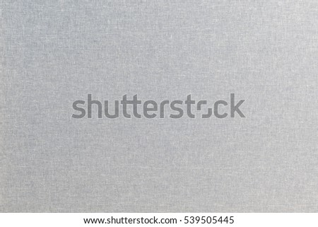 Light linen texture background, close up view with studio light