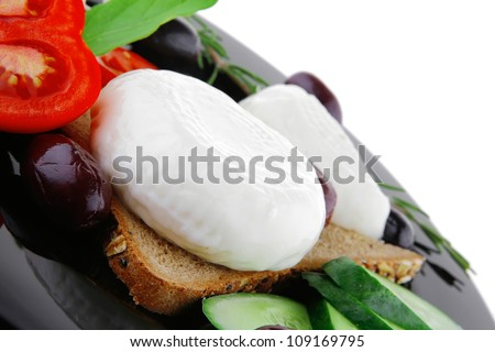 light mozzarella cheese on black dish over white