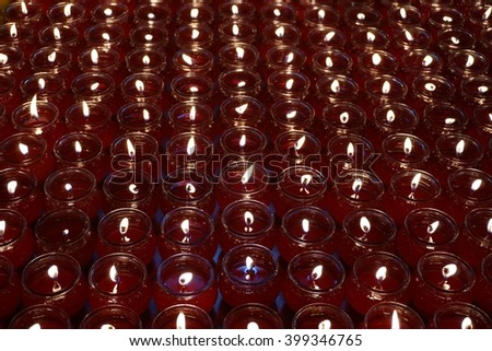 light of candle in the glass cup used for offering in Chinese New Year